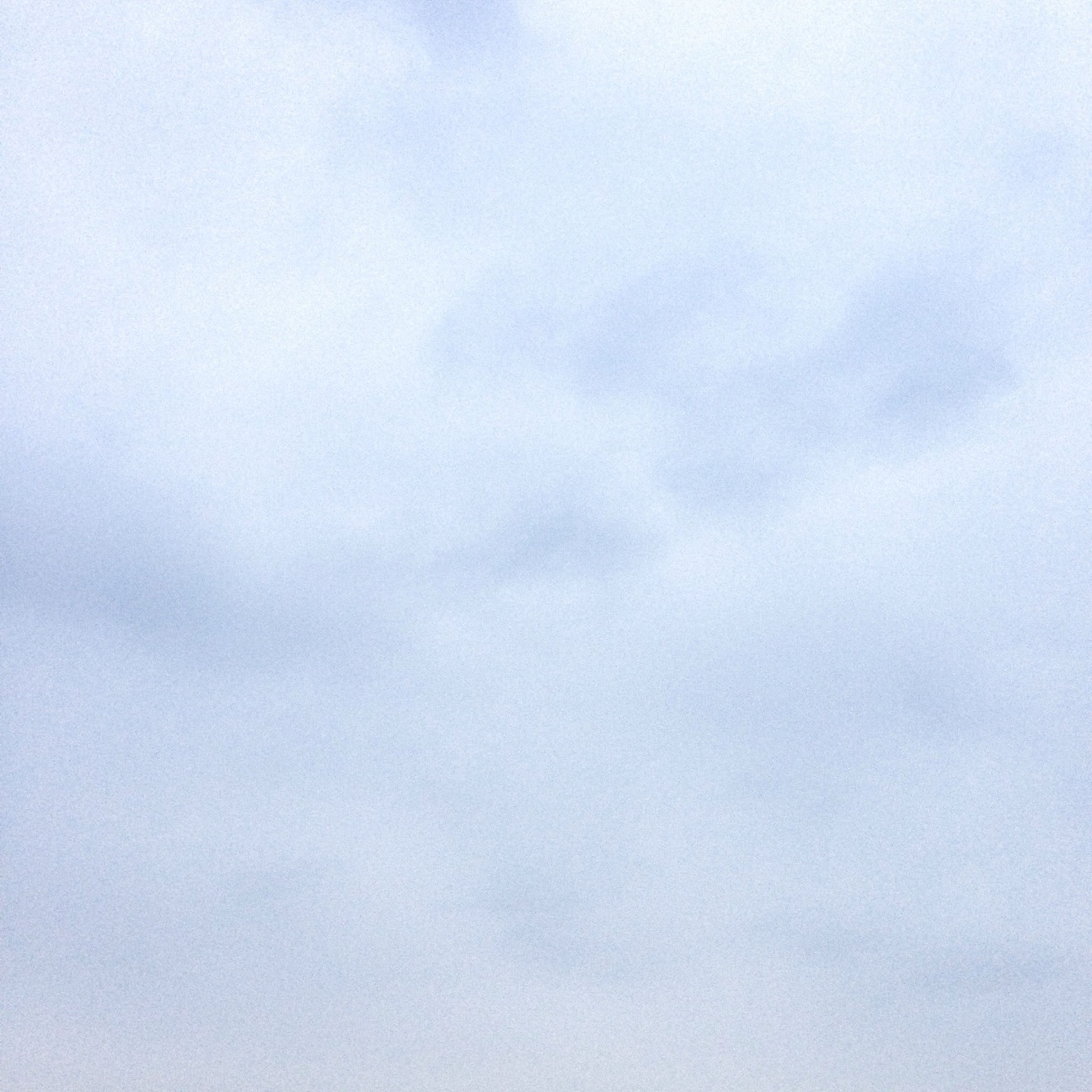 sky, low angle view, tranquility, beauty in nature, copy space, cloud - sky, scenics, nature, tranquil scene, weather, cloudy, overcast, backgrounds, sky only, outdoors, no people, day, idyllic, cloud, white color