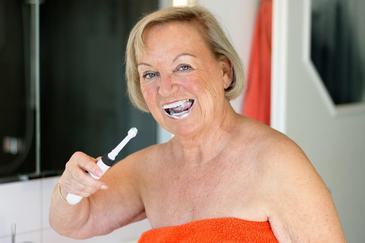 Beautiful stock photos of badezimmer,  75-79 Years,  Blond Hair,  Brushing Teeth,  Caucasian Ethnicity