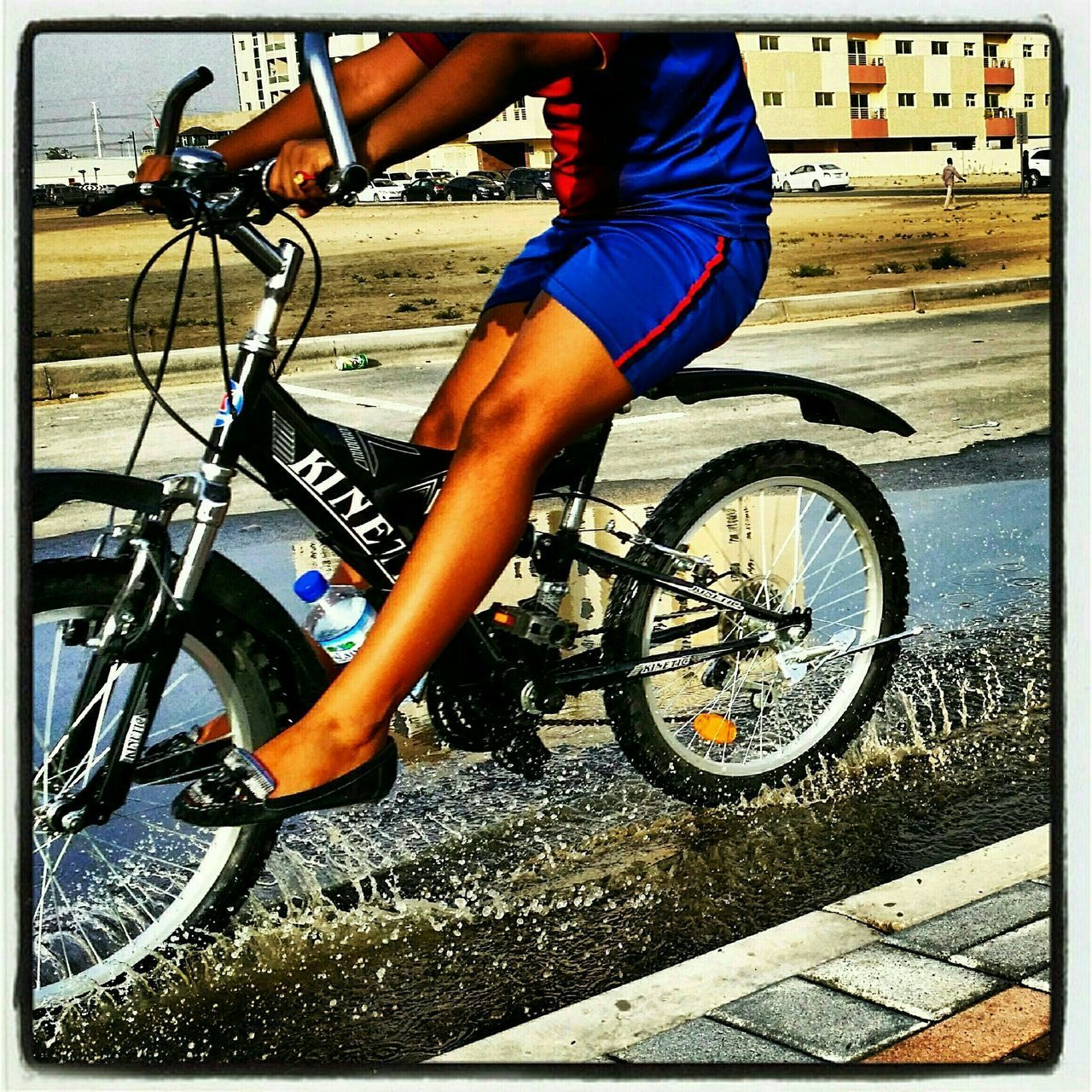 bicycle, transportation, cycling, land vehicle, mode of transport, real people, day, riding, outdoors, one person, side view, wheel, water, sport, men, lifestyles, adventure, low section, bmx cycling, tire, mountain bike, sports race, cycling helmet, human hand, close-up, people