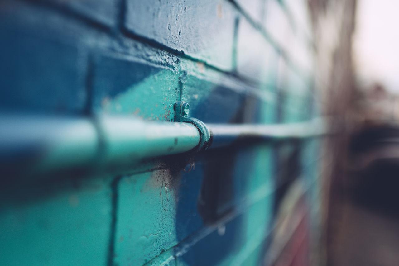 Close-up Day Grafitti Grafitti Street Art Grafitti Wall No People Outdoors Pipe Selective Focus Wall
