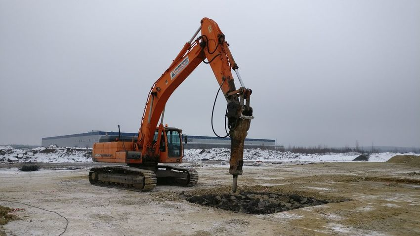 Cold Temperature Construction Machinery Construction Site Day Development Digging Earth Mover Industry Machinery No People Outdoors Progress Quarry Sky Winter