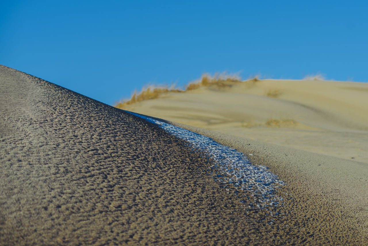 Sand and Snow | Nida | Lithuania Beauty In Nature Blue Sky Curonian Spit Day Landscape Landscapes Lietuva Nature Nature No People Outdoors Sand Sand Dune Sunny Day Winter