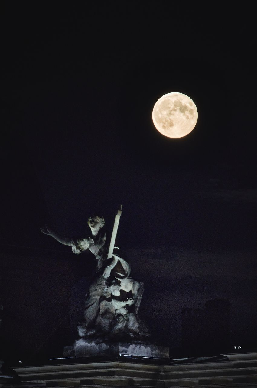 statue, night, moon, sculpture, human representation, art and craft, illuminated, low angle view, outdoors, no people, sky, astronomy