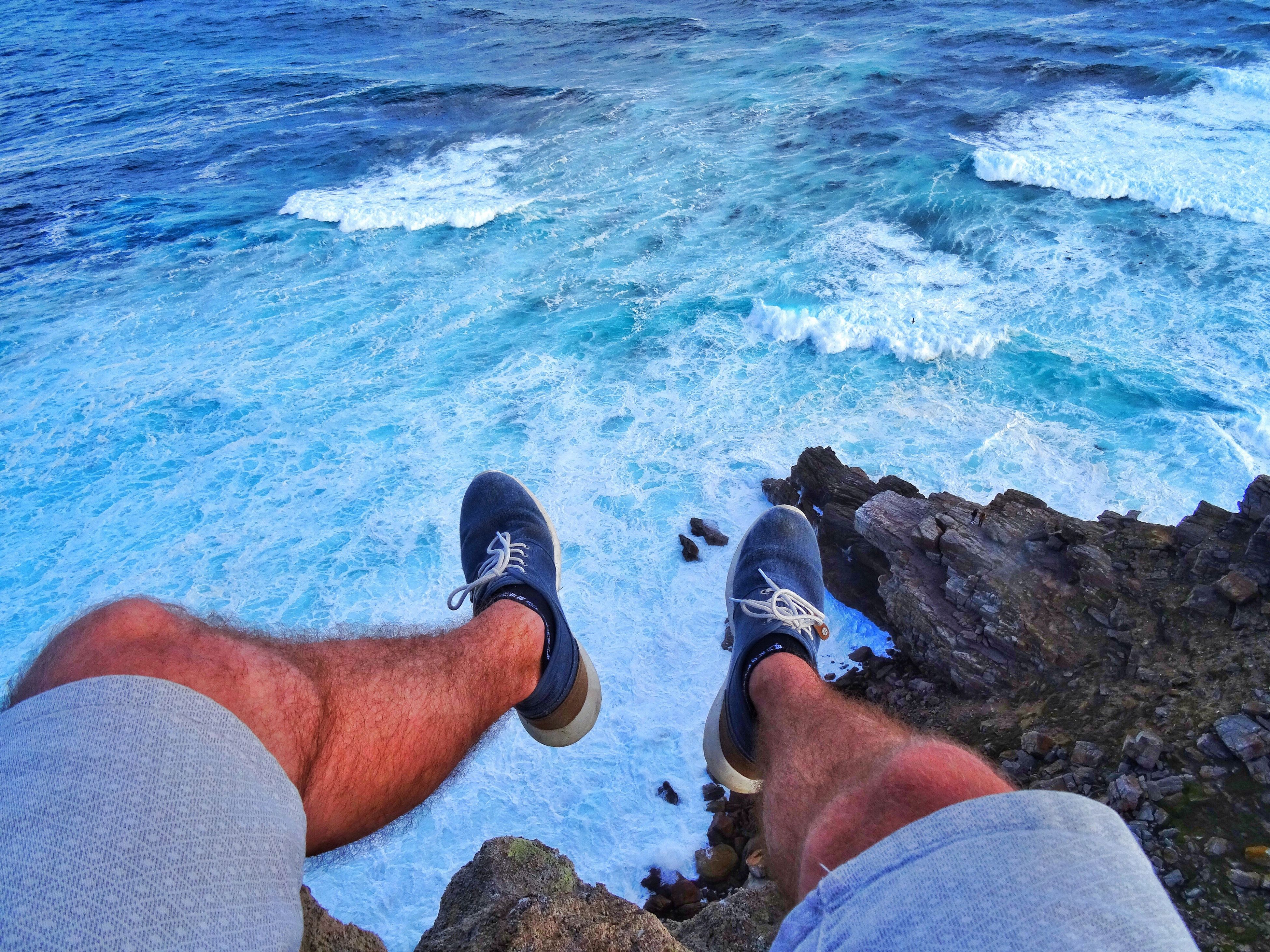 human leg, low section, blue, two people, human body part, personal perspective, real people, lifestyles, men, water, outdoors, leisure activity, day, standing, swimming pool, adults only, low angle view, adult, people, close-up, togetherness, sand, only men