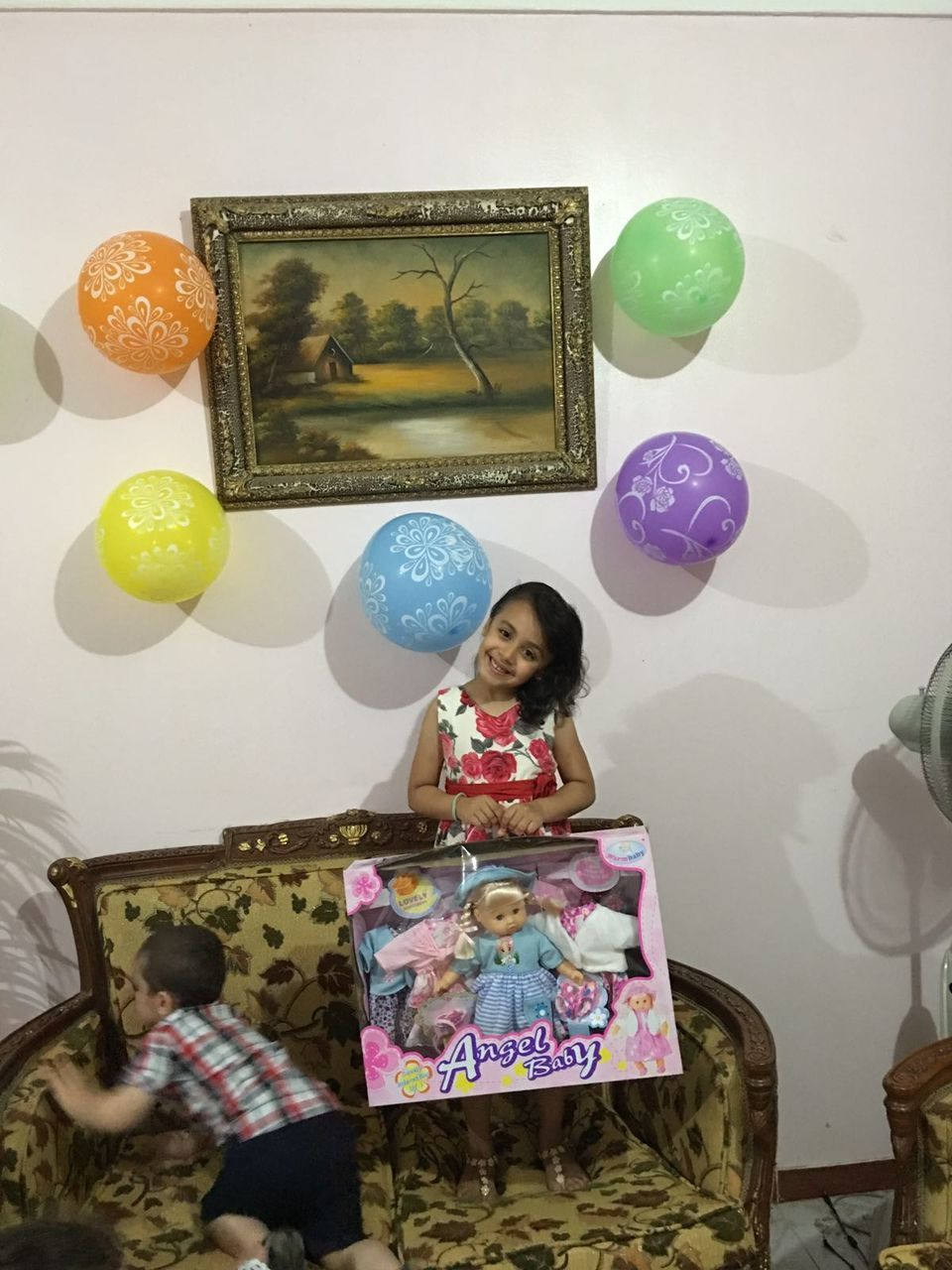 one person, picture frame, real people, home interior, indoors, balloon, lifestyles, photograph, young adult, day, people