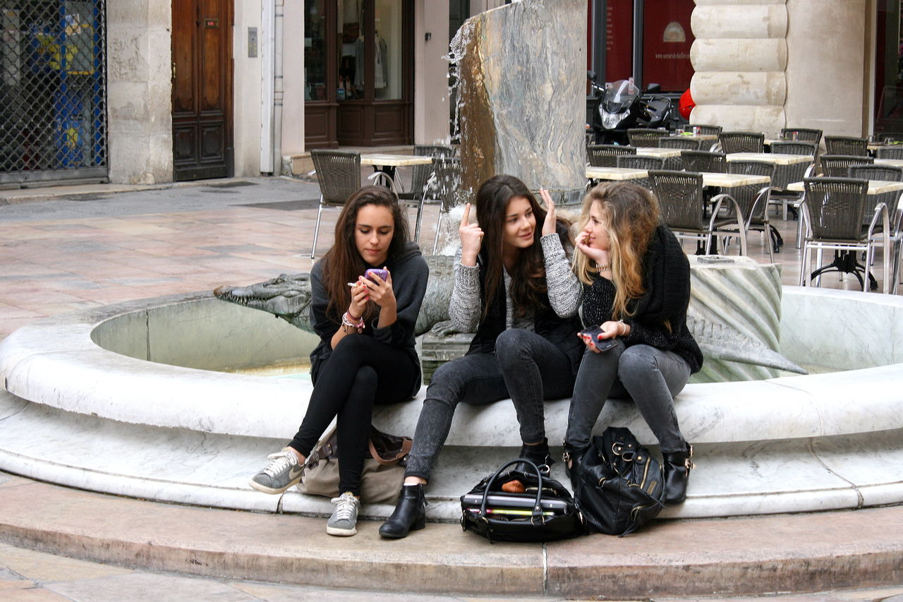 Canon Eos 400d Casual Clothing City Day Fashion Fountain France Front View Girls Handbags LanguedocRoussillon Lifestyles Long Hair Outside Person Shopping Sitting Street Photography Streetphotography Three Girls Togetherness Young Adult Young Women