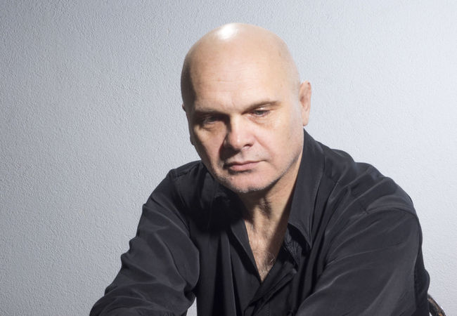Emotional caucasian bald mature man in black shirt. Sad Adult Bald Black Casual Clothing Caucasian Confidence  Dolorous Dreary Emotional European  Front View Lamentable Looking At Camera Man Mature Melancholy Person Portrait Sad Shirt Sorry Studio Shot Waist Up White Background Young Adult