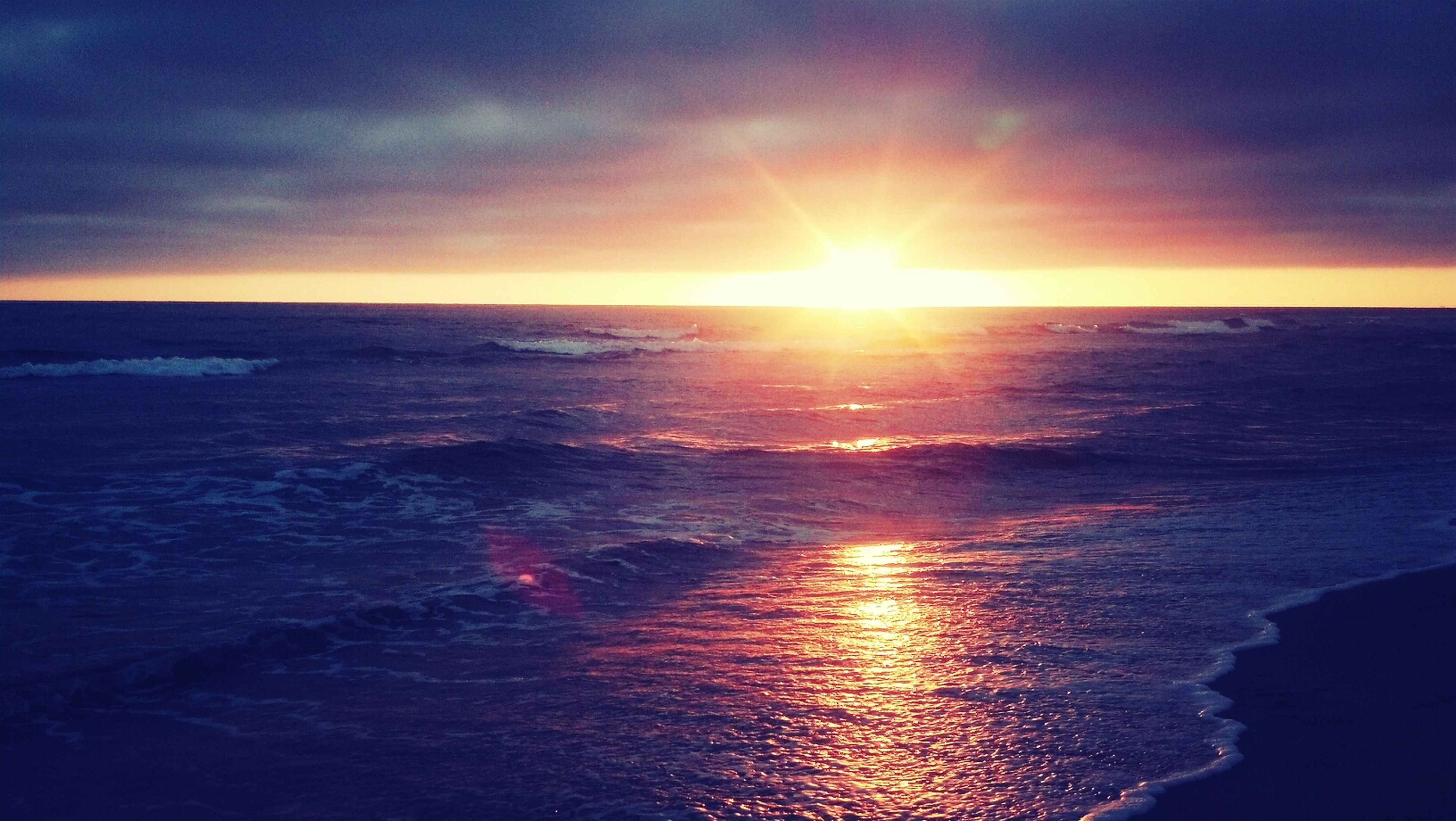 water, sea, sunset, horizon over water, sun, scenics, tranquil scene, beauty in nature, reflection, tranquility, sky, waterfront, idyllic, nature, sunlight, orange color, seascape, rippled, cloud - sky, beach
