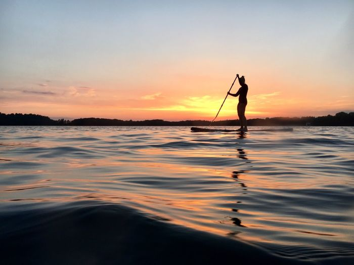 Sunset on a sup Water Silhouette Sunset One Person Men Nature Outdoors Real People Beauty In Nature Sea Tranquil Scene Scenics Waterfront Leisure Activity Paddleboarding Sky Standing Oar Day Adult