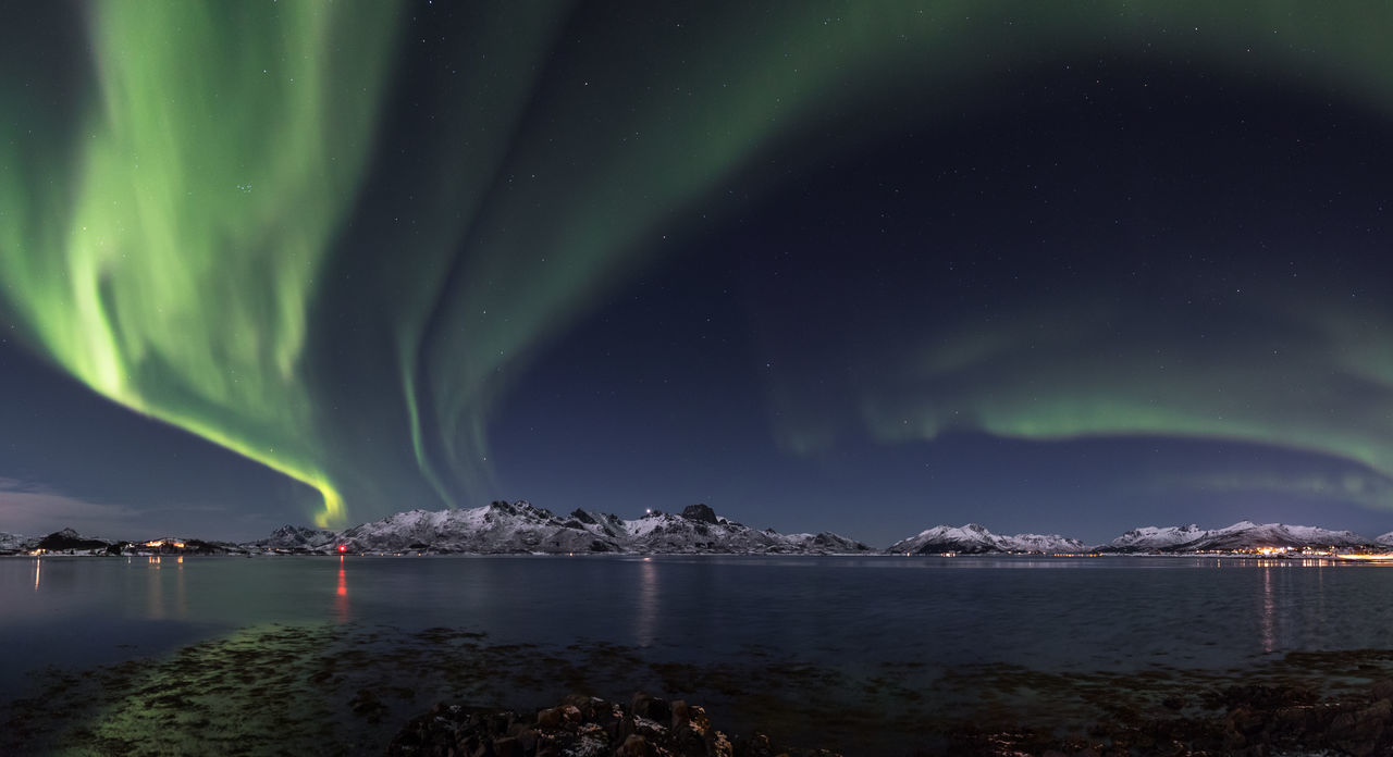 Aurora Borealis Aurora Polaris Awe Beauty Beauty In Nature Cold Temperature Dramatic Sky Environment Green Color Illuminated Landscape Mountain Natural Phenomenon Nature Night Norway Outdoors Sky Snow Space And Astronomy Star - Space Tranquility Vesterålen Water Winter