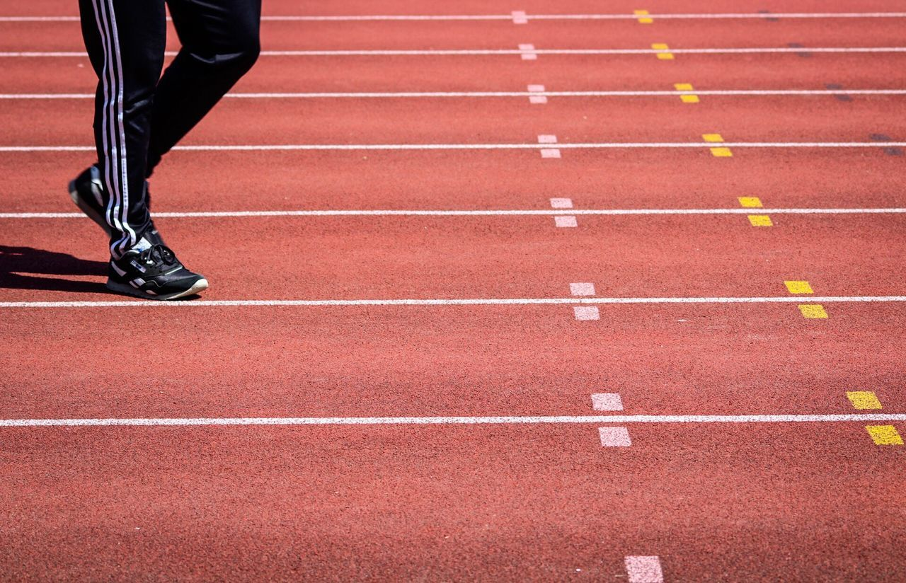 Running Track Sports Track Track And Field Athlete Running Sports Race Sport Track And Field Competition Low Section Lifestyles Sprinting Track And Field Event Track Event Day Outdoors Sports Clothing Competitive Sport One Person Only Men Starting Line