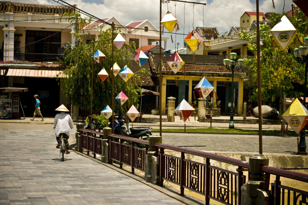 Architecture ASIA Bicycle Building Exterior Built Structure City Cycling Day Footpath Here Belongs To Me Hoi An House Incidental People Lifestyles Men Outdoors Person Railing Sidewalk Sky Street Street Light Typical Vietnam Walking