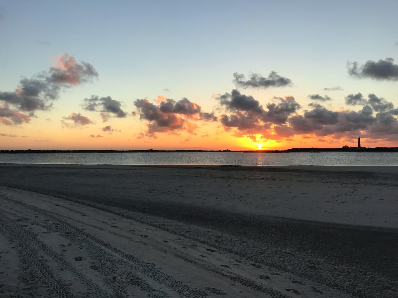 beach, sunset, sea, sand, scenics, nature, sky, tranquility, beauty in nature, tranquil scene, water, shore, horizon over water, idyllic, cloud - sky, no people, sun, silhouette, outdoors, day