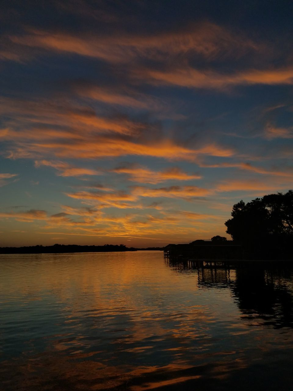 sunset, silhouette, water, nature, sky, beauty in nature, scenics, tranquility, tranquil scene, reflection, lake, outdoors, no people, tree, cloud - sky