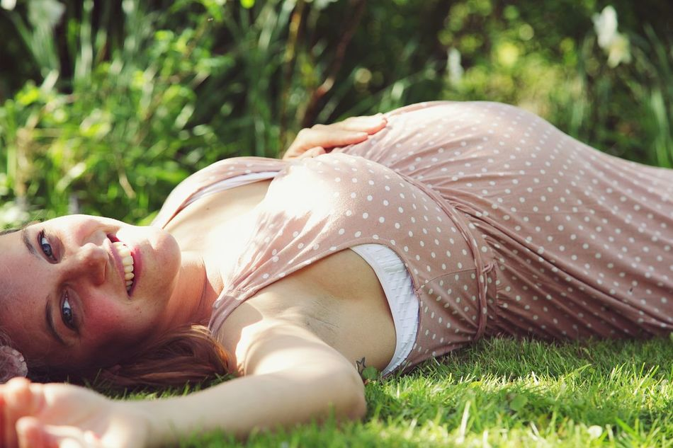 Relaxation Only Women One Woman Only One Person Outdoors Grass Sunlight Lying Down Young Adult Nature Portrait Babybelly Baby Belly Pregnant Pregnancy Polka Dots  Woman Woman Portrait Beautiful Woman Motherhood Smile Smiling Happy Women Around The World EyeEmNewHere