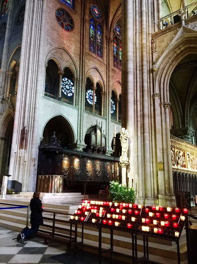 Devotion Notre Dame De Paris Paris, France  Kneeling HAIL MARY Candles Temple - Building Worship Church Vaulted Ceiling International Landmark Spirituality Praying Worshipping Place Of Worship Spirituality Religion Church Cathedral Person Worship Stained Glass Window Vaulted Ceilings