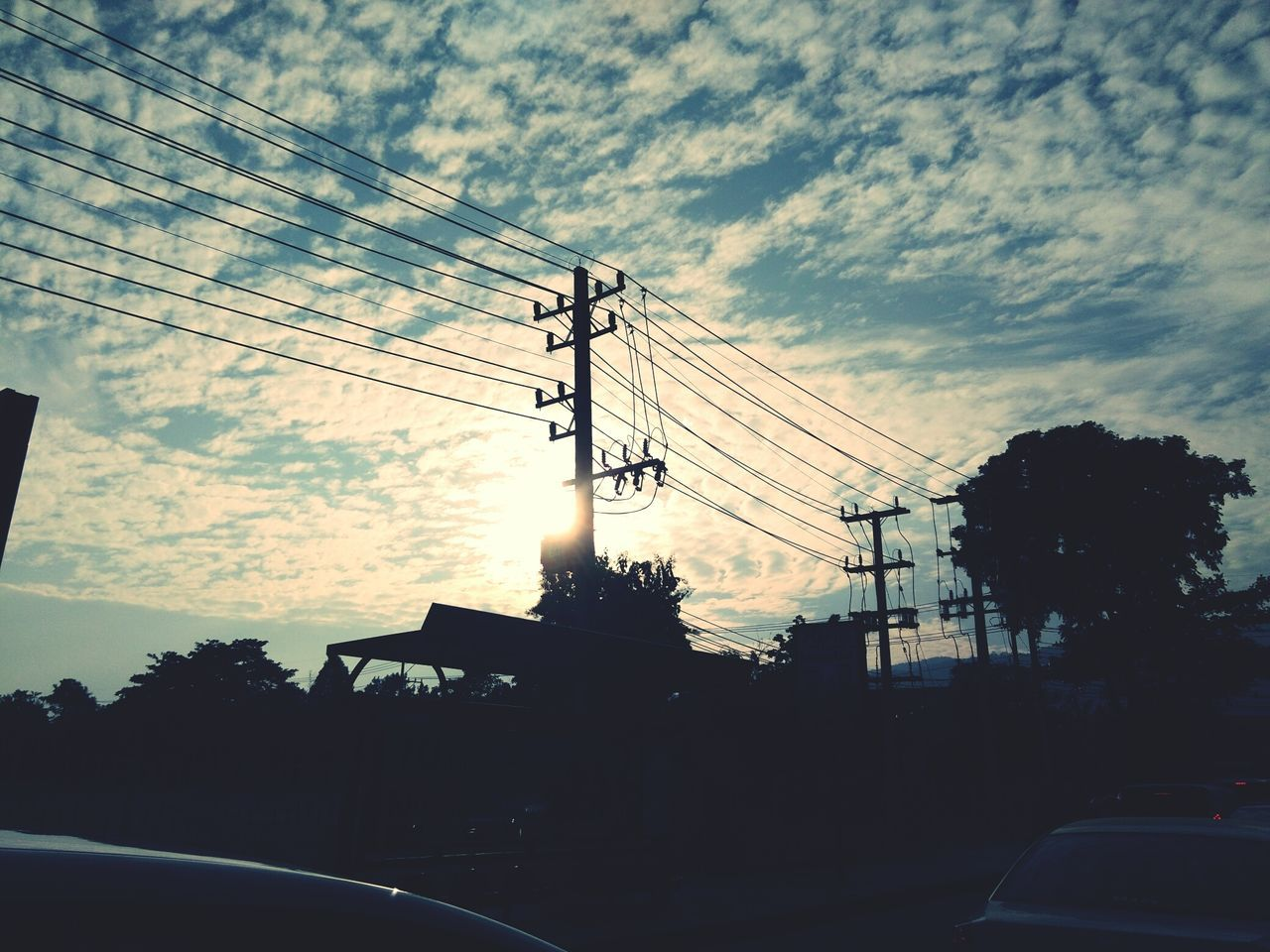 cable, sky, connection, cloud - sky, electricity pylon, silhouette, power line, electricity, car, low angle view, technology, transportation, power supply, tree, built structure, land vehicle, sunset, fuel and power generation, no people, day, outdoors, architecture, nature, telephone line