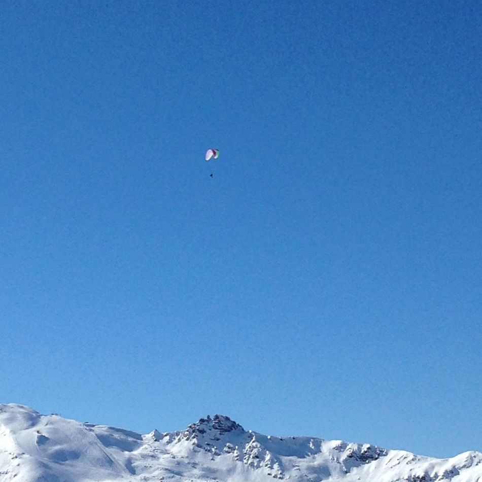 Paraglider over the slopes in Meribel Paragliding Paraglider Meribel Slopes Snow
