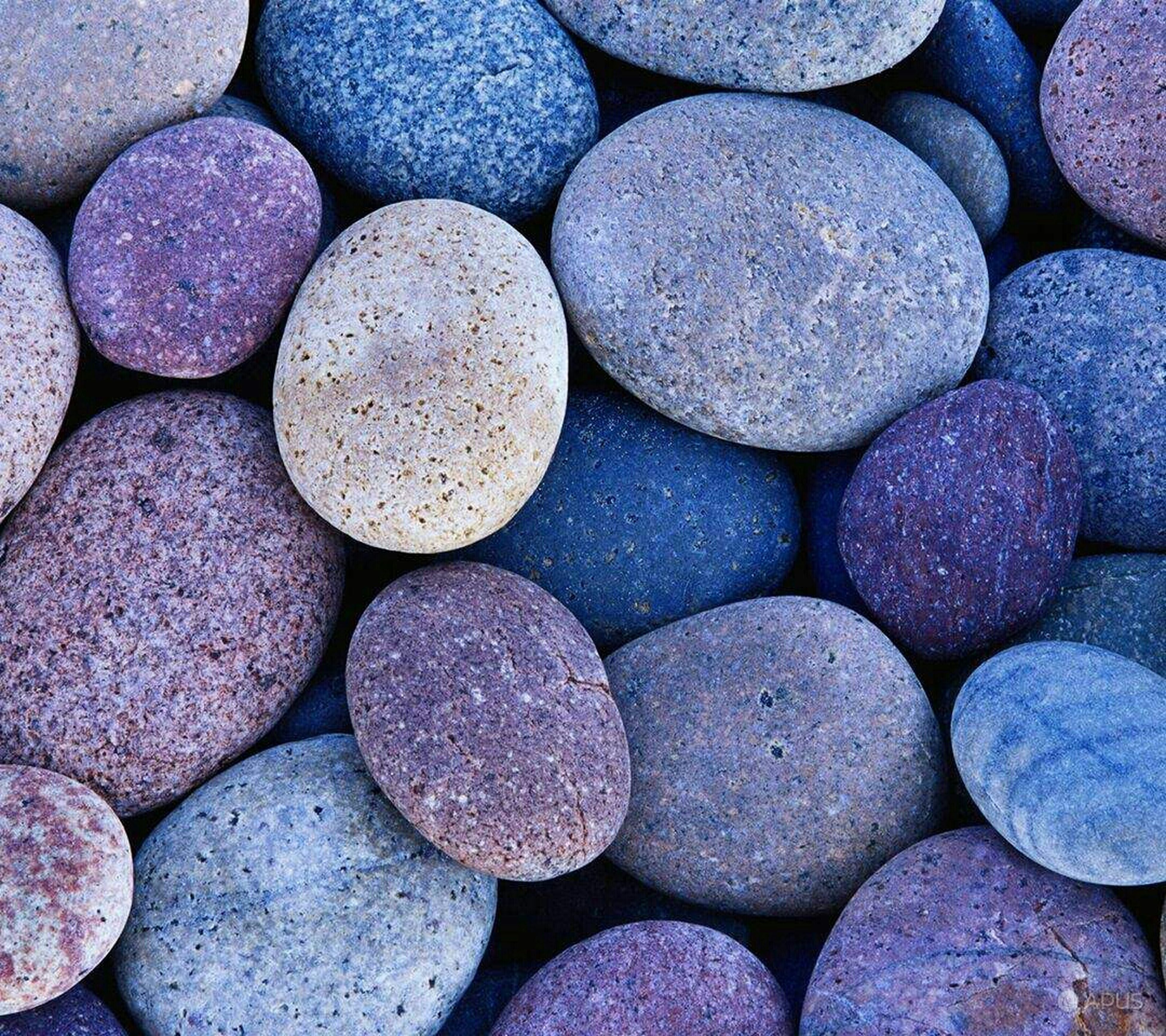 backgrounds, full frame, large group of objects, abundance, stone - object, pebble, textured, stack, beach, stone, pattern, outdoors, no people, rock - object, day, high angle view, close-up, heap, nature, log
