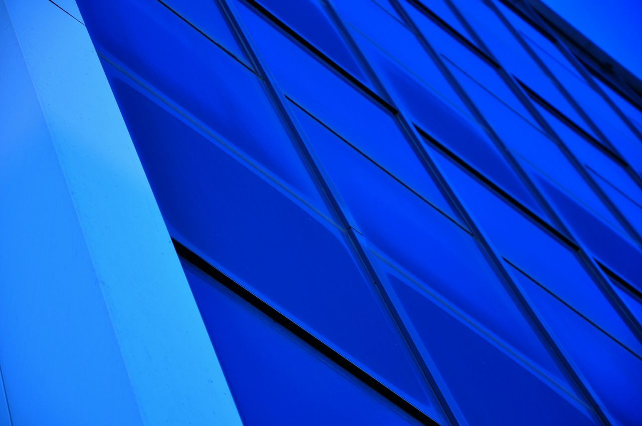 Architectural Detail Of Blue Building Against Sky