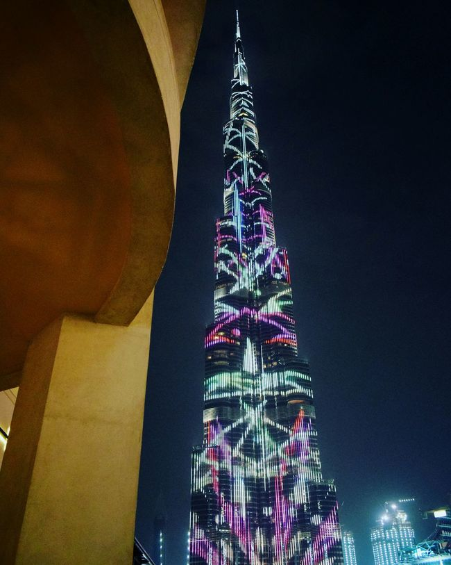 Illuminated Low Angle View Night Built Structure Architecture Building Exterior City Sky Spire  Tall - High Fairy Lights Multi Colored No People Tourism Burj Khalifa DXB Dubai Dxblife Dubai Life