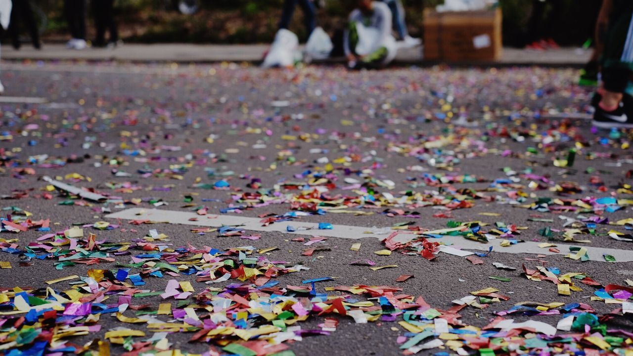 multi colored, large group of objects, abundance, focus on foreground, day, confetti, celebration, close-up, leaf, outdoors, puzzle, no people