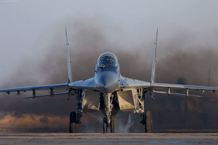 Aerospace Industry Air Base Air Force Air Vehicle Airplane Day Engine Fighter Fighter Jet Fighter Plane Frontal View Head On Jet Engine Mig-29 Mikoyan I Gurevich Mikoyan Mig-29 No People Outdoors Sky Smoke Starting