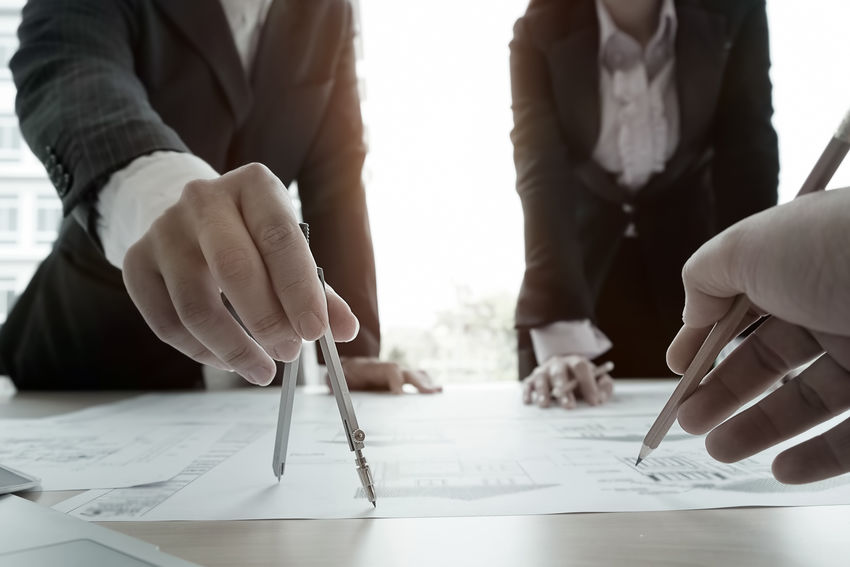 architecture plan on desk. Architecture Business Businessman Close-up Colleague Day Engineering Friendship Holding Human Body Part Human Hand Indoors  Meeting Men Occupation Paper People Real People Table Teamwork Togetherness Women Working Writing