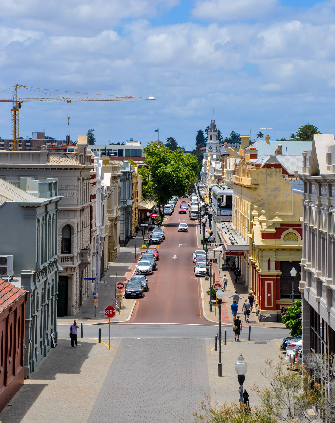 Elevated view overlooking High Street with building facades and tourists in the travel destination and historic town of Fremantle, Western Australia. Architecture Building Building Exterior Built Structure Car City City Life Cloud - Sky Development Diminishing Perspective Downtown Elevated View Facades Fremantle, Western Australia High Angle View High Street Historic Incidental People Mode Of Transport Sky Street The Way Forward Tourists Travel Destinations Vanishing Point