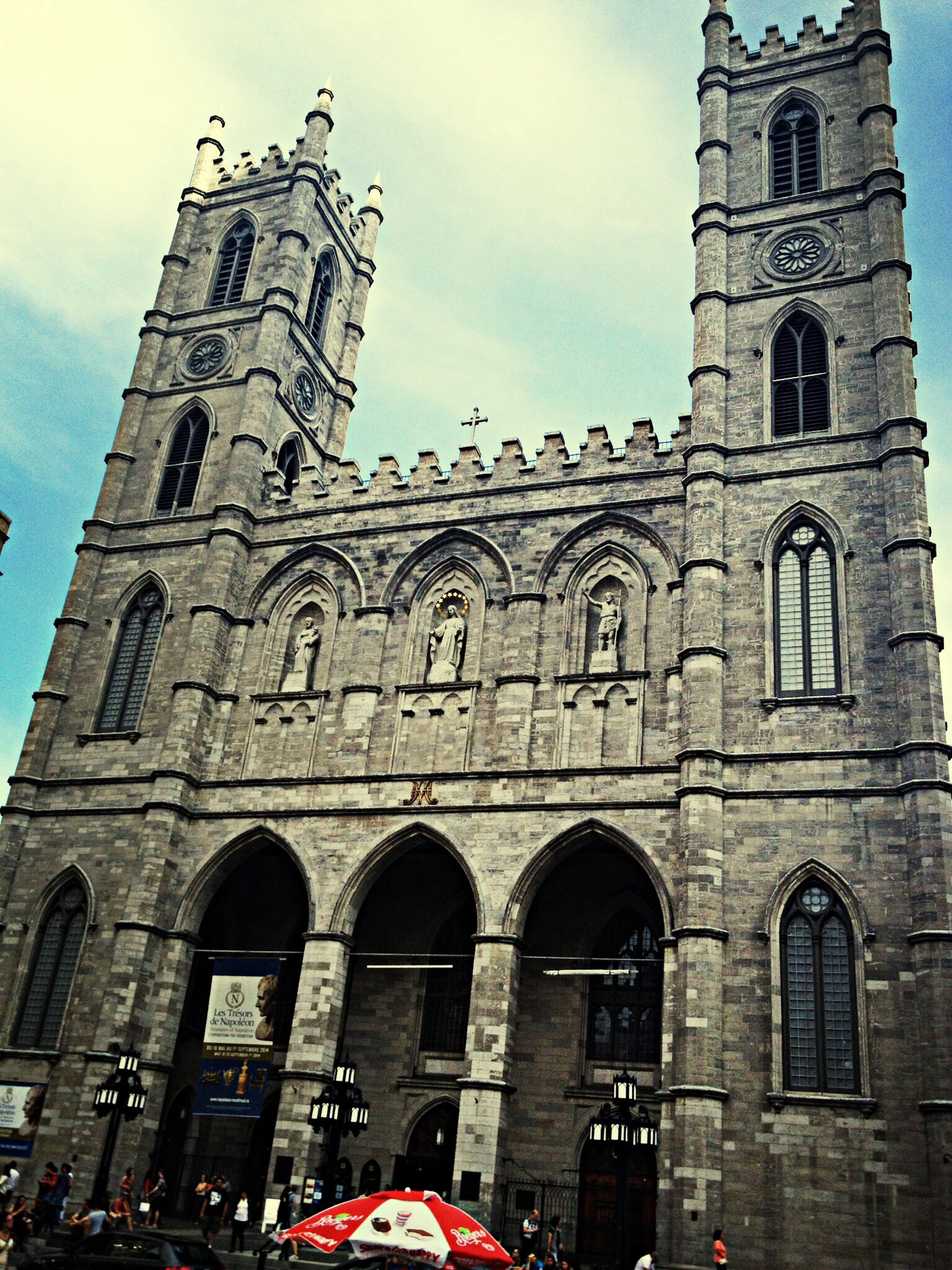 architecture, building exterior, built structure, religion, low angle view, arch, church, place of worship, history, sky, spirituality, travel destinations, cathedral, facade, old, travel, famous place, window