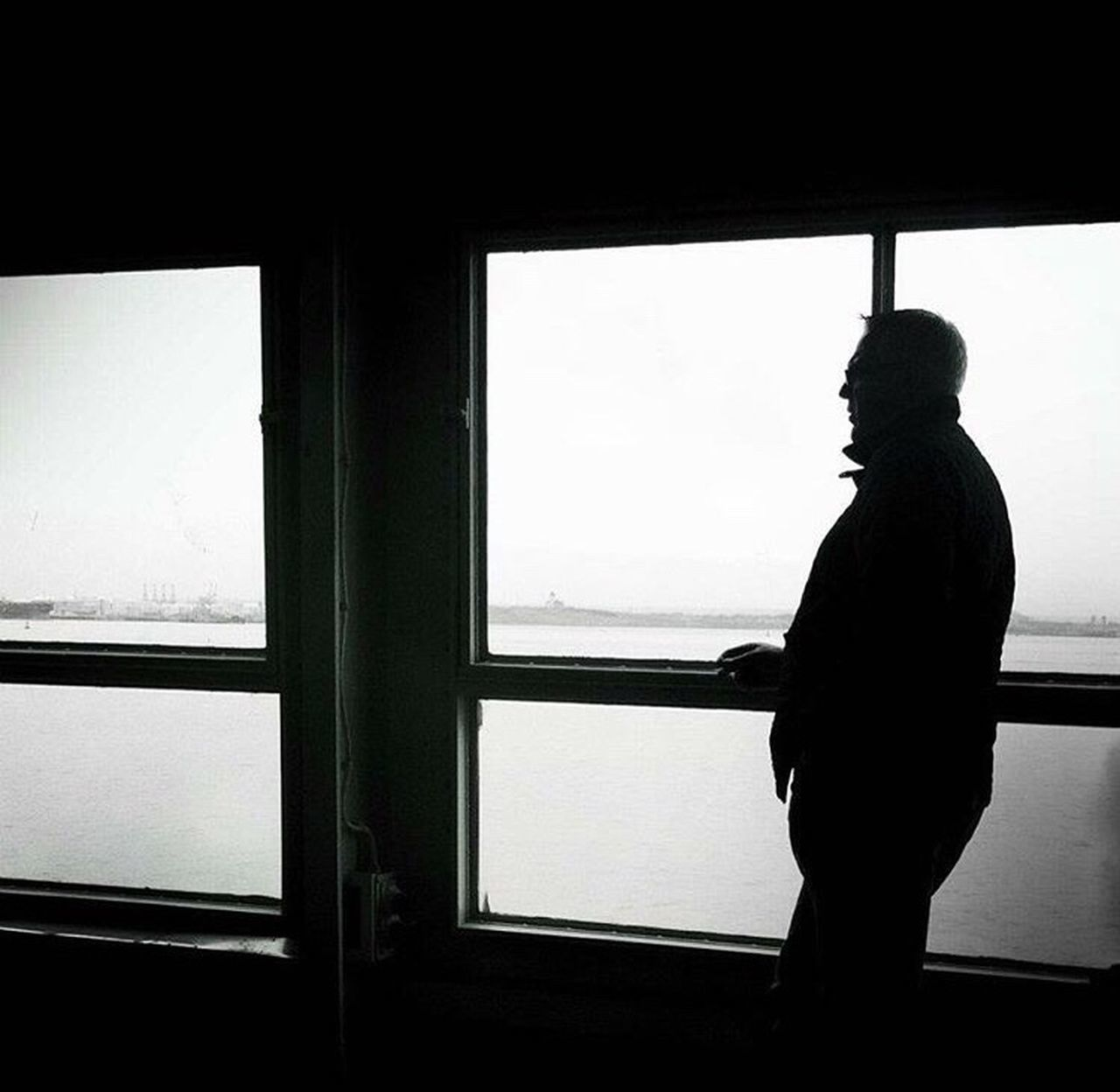 Reflecting in the shadows Subjectlight Shadow Window Contemplation Commute Staten Island Ferry Commuter