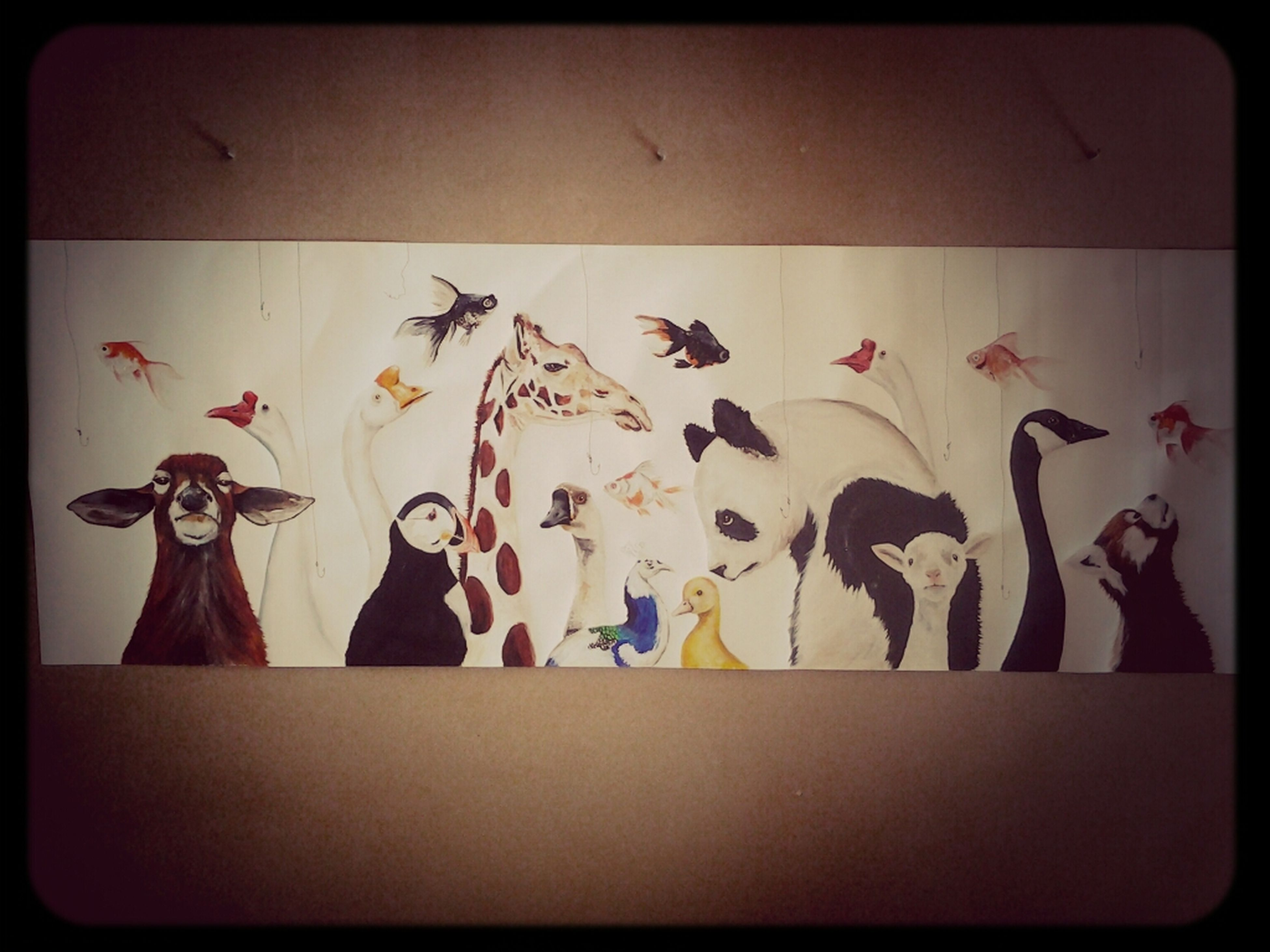 indoors, transfer print, art and craft, creativity, art, animal representation, auto post production filter, human representation, wall - building feature, variation, wall, hanging, decoration, paper, multi colored, no people, still life, close-up