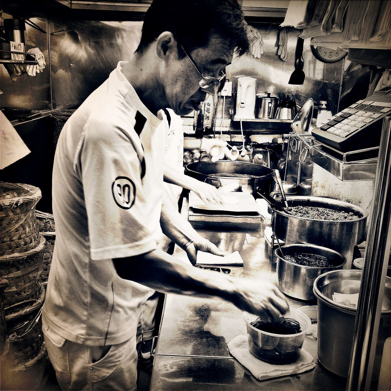 real people, one person, indoors, casual clothing, mature adult, standing, side view, mature men, commercial kitchen, kitchen, young adult, working, chef, occupation, freshness, day, people