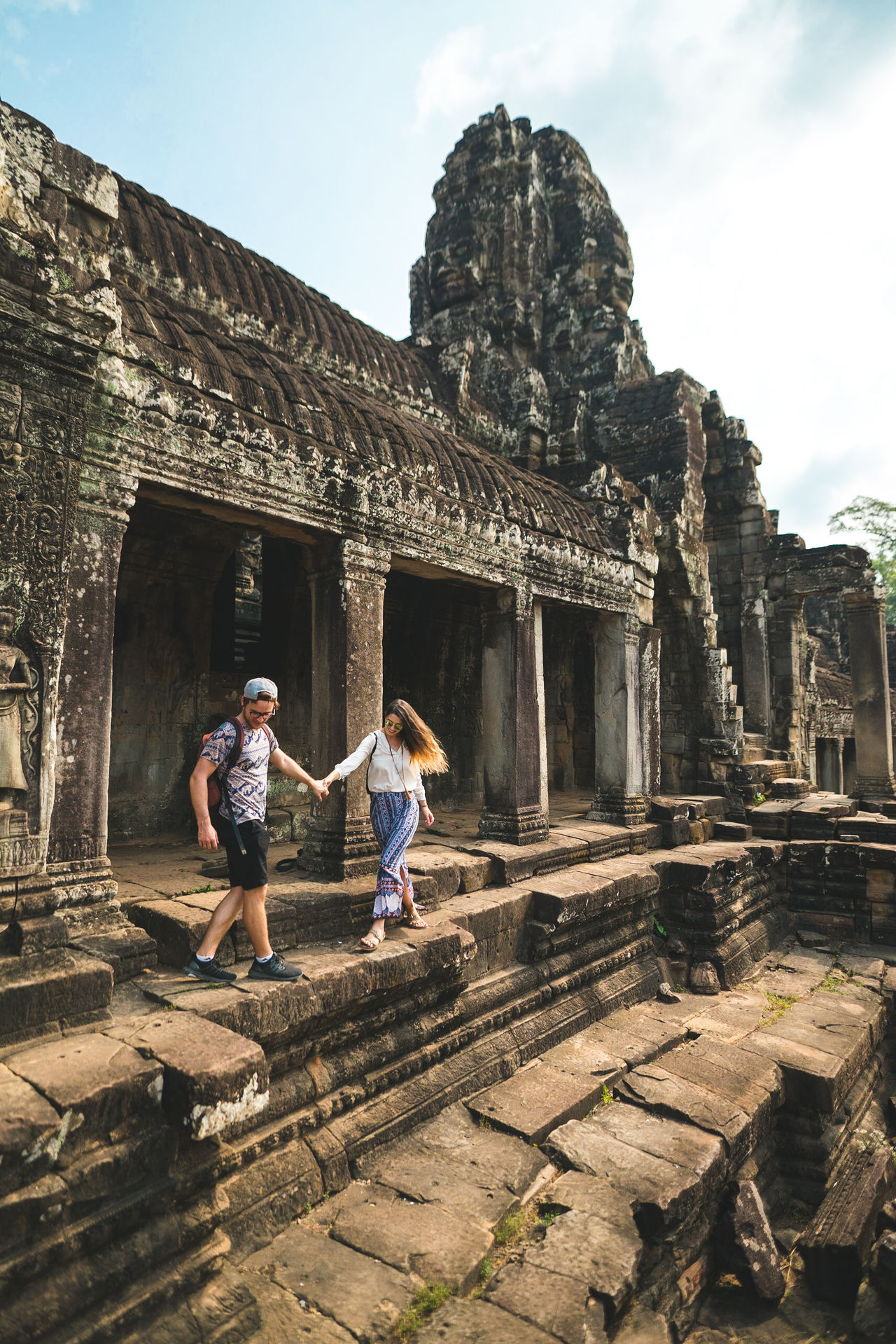 Enjoy the world. Don't stay home. Two People Adult People Togetherness Vacations Architecture Architecture Built Structure Building Exterior Travel Old Ruin Ancient Civilization Wonder Of The World Cambodia Real Life ASIA Temple Culture Showcase May Full Frame Travel Destinations Religion Travel Photography