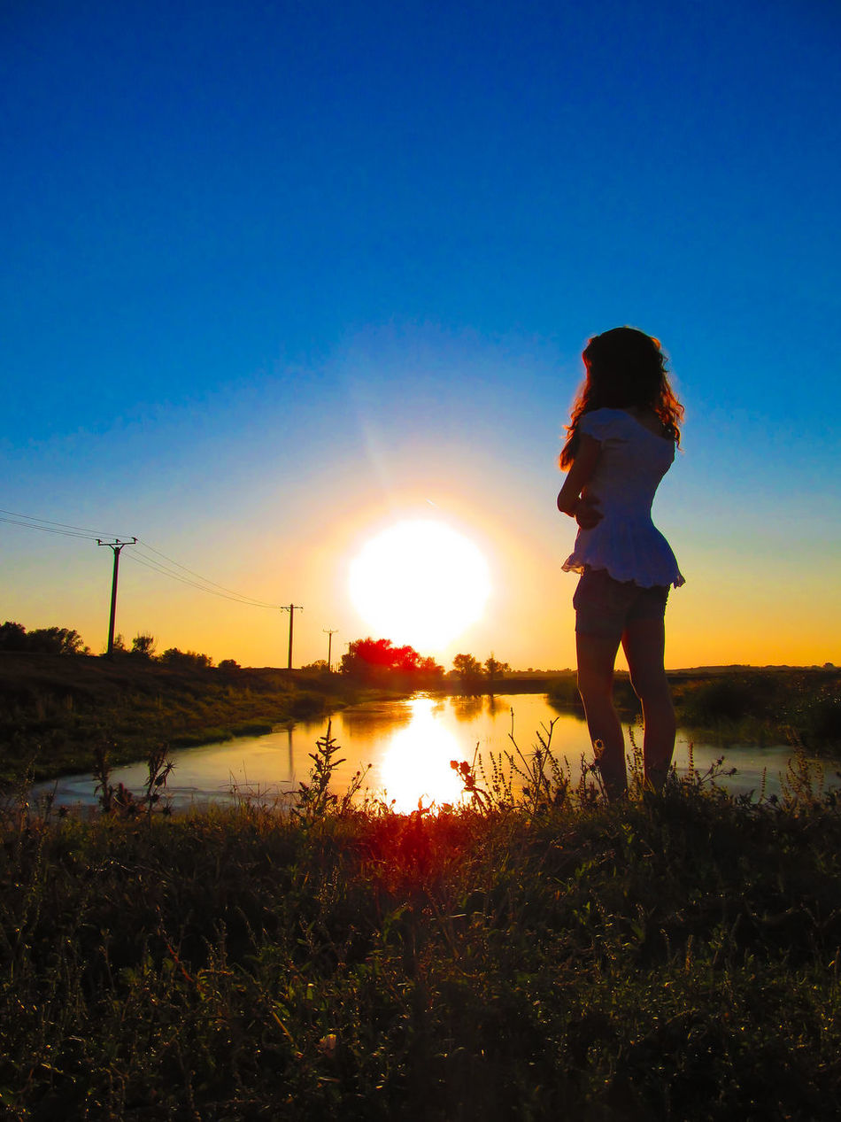 Beauty In Nature Danube Day Field Girl Landscape Lifestyles Nature One Person Outdoors People Real People Romania Rural Scene Scenics Silhouette Sky Sun Sunbeam Sunlight Sunset Tranquility Woman