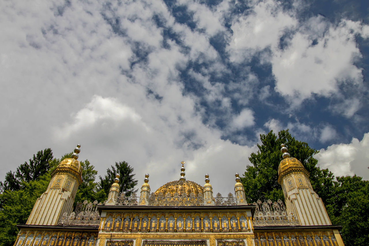 architecture, built structure, sky, cloud - sky, history, religion, tree, place of worship, travel destinations, day, building exterior, spirituality, dome, low angle view, outdoors, no people, sculpture, nature