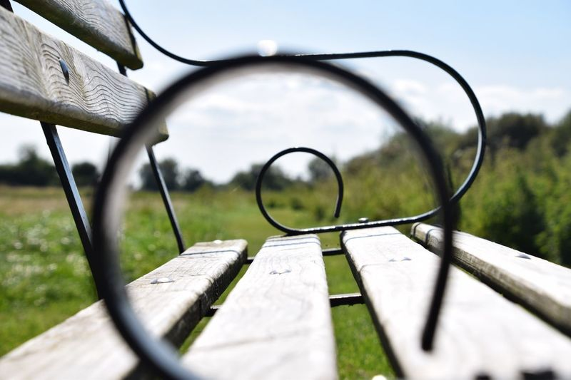 Magnifying Glass Day No People Outdoors Close-up View Through Summer Perspective Photography Grass Nature Sky Bench Wooden Bench Circles