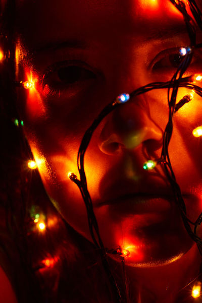 Christmas Lights Close-up Colour Portrait Colours Creative Light And Shadow Experimenting Illuminated Looking At Camera Lowlight Photography Portrait Real People Self Portrait Selfie Time Selfie ✌ Taking Photos