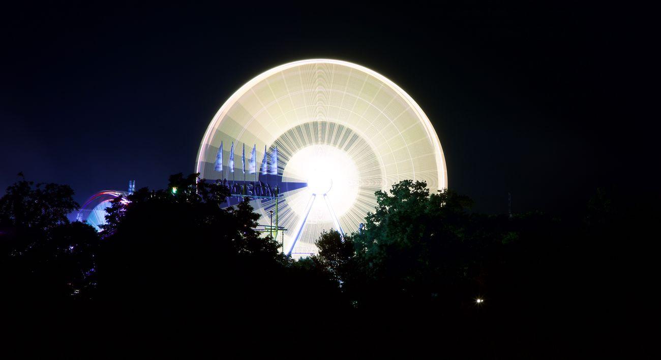 ferris wheel Amusement Park Amusement Park Ride Arts Culture And Entertainment Ferris Wheel Illuminated Night No People Outdoors Sky Tree