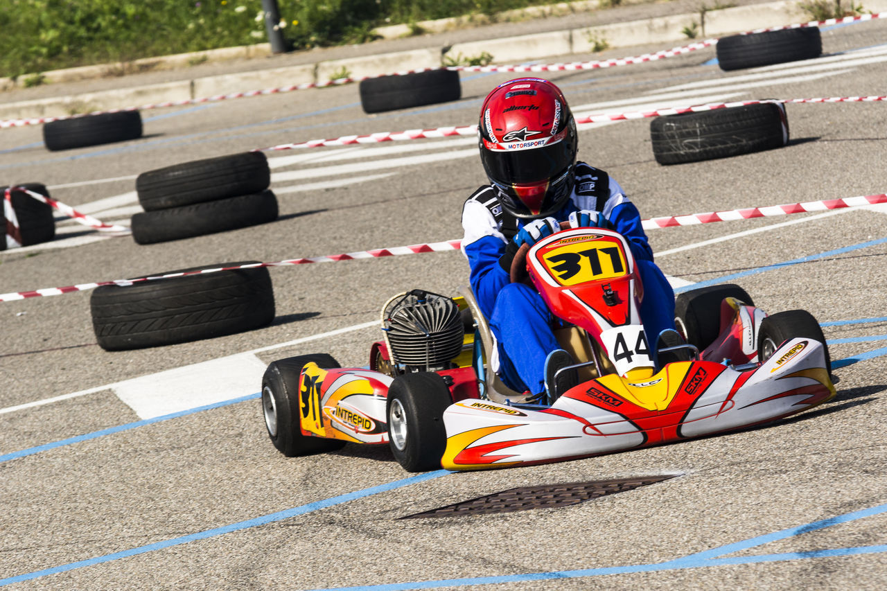 portrait of a go kart at a public event held in a parking lot Auto Racing Competition Day Finish Line  Formula One Racing Motor Racing Track Motorsport Outdoors People Racecar Speed Sport Sports Race Sports Track Two People