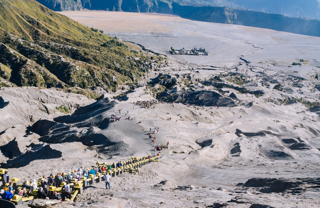 large group of people, mountain, real people, leisure activity, day, nature, men, outdoors, landscape, high angle view, beauty in nature, adventure, lifestyles, scenics, sky, people, adult