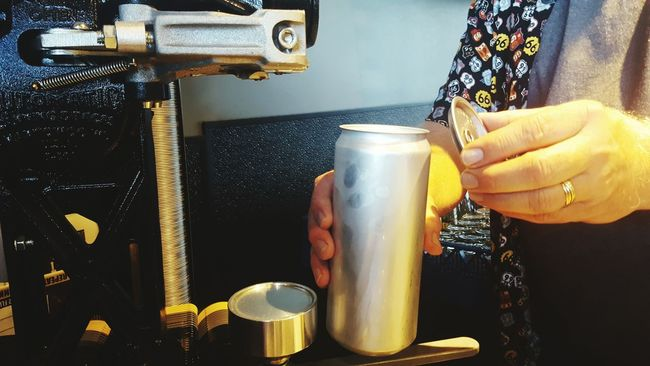 Person Holding Freshness Color Image Frosty Cold Lid Machine Alcohol Inside No Face Profession Man's Arm Wedding Ring Hands At Work Fabrication Canning Beer Aluminum Micro-brewery Oregon Bartender Can Cap Color Of Technology