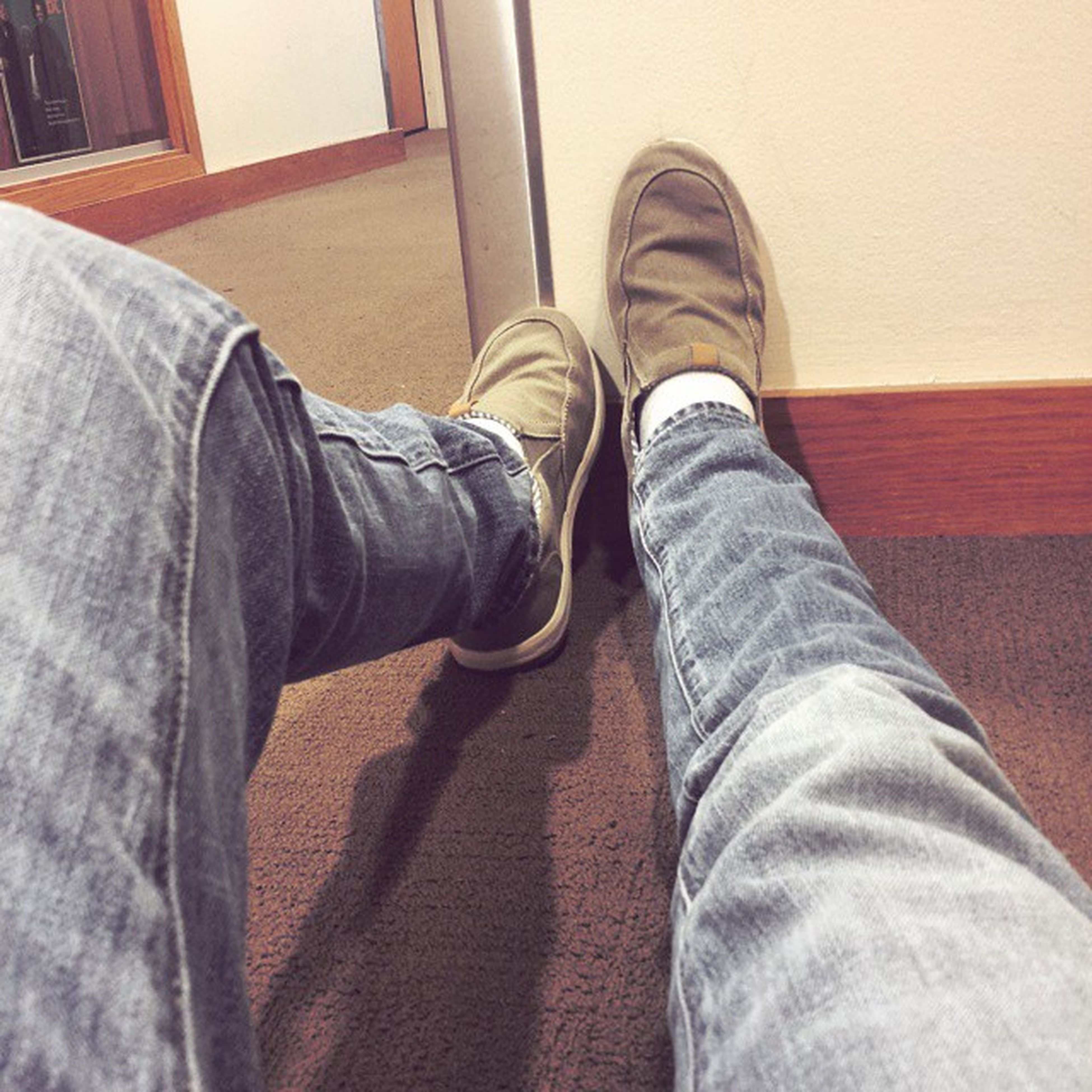 low section, person, shoe, jeans, personal perspective, indoors, human foot, footwear, standing, lifestyles, men, legs crossed at ankle, casual clothing, relaxation, part of, denim, unrecognizable person