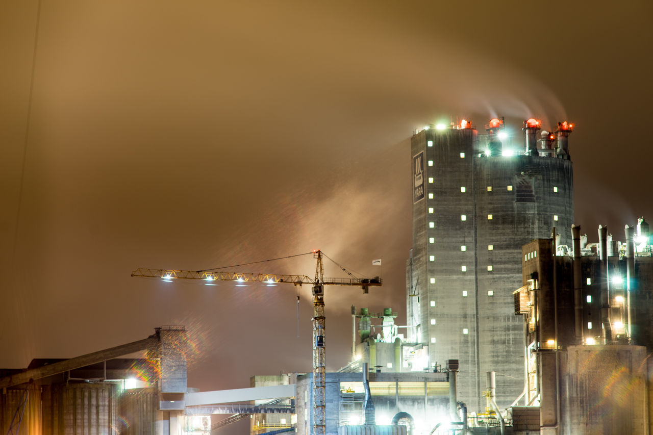 night, illuminated, city, architecture, building exterior, built structure, sky, no people, outdoors, smoke - physical structure, factory