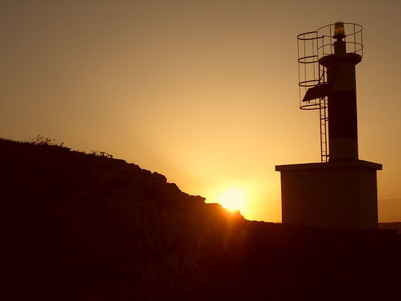 sunset, silhouette, outdoors, no people, sunlight, scenics, sky, nature, beauty in nature, architecture, day
