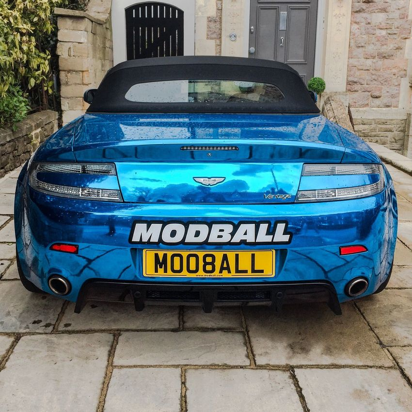 The Owner of the Modballrally 's Chrome Blue Aston Martin varntage Car Cars Land Vehicle Blue Transportation Outdoors Parking Day Road Vehicle Supercar Aventador Lamborghini Ferrari New Hypercar Sportscar