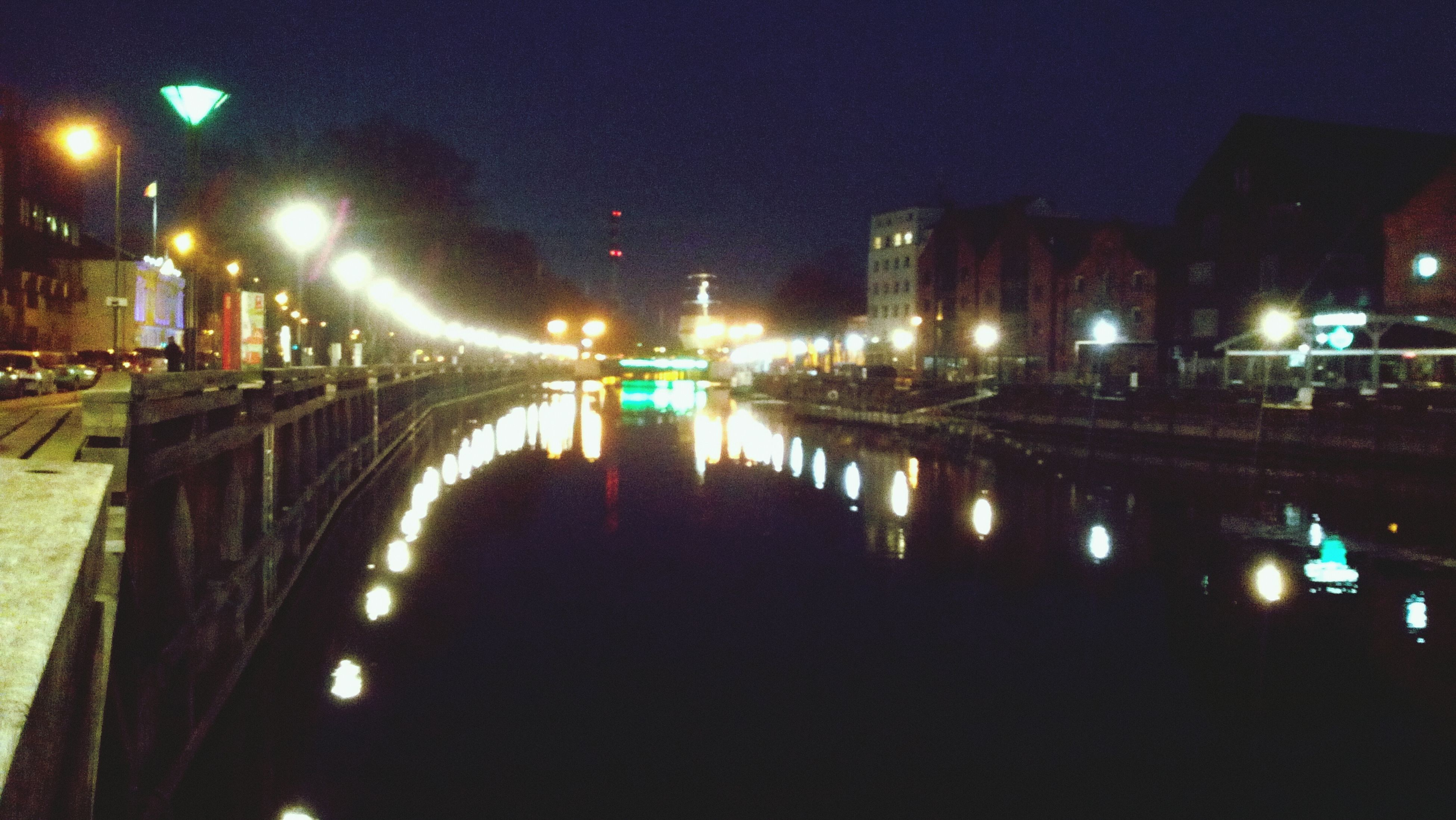 illuminated, night, street light, reflection, architecture, built structure, lighting equipment, water, city, building exterior, transportation, connection, the way forward, river, bridge - man made structure, canal, light - natural phenomenon, waterfront, street, sky
