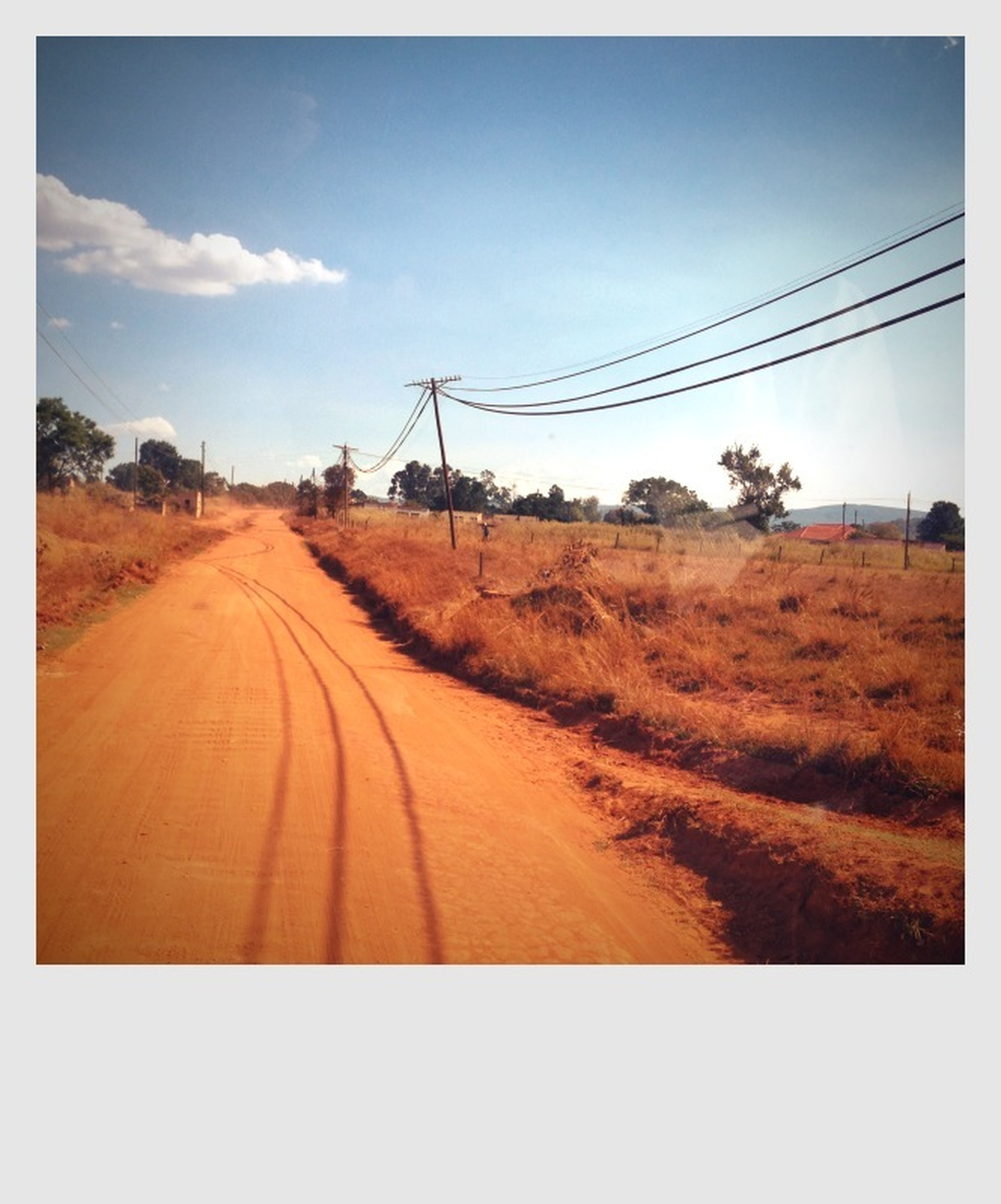 the way forward, diminishing perspective, landscape, sky, vanishing point, transportation, road, tranquil scene, dirt road, field, tranquility, country road, rural scene, transfer print, electricity pylon, nature, power line, long, cloud, auto post production filter