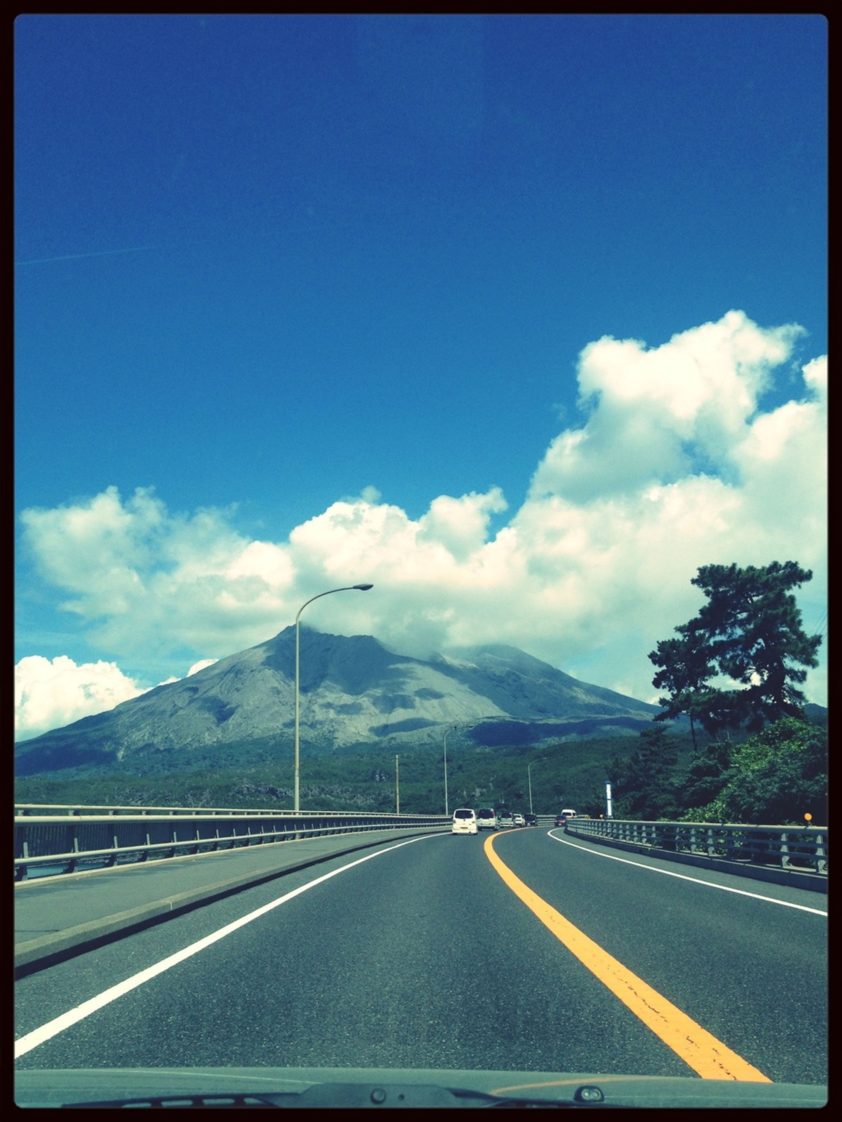 road, transportation, road marking, the way forward, mountain, sky, transfer print, diminishing perspective, highway, vanishing point, mountain range, country road, auto post production filter, car, blue, street, cloud, cloud - sky, asphalt, empty