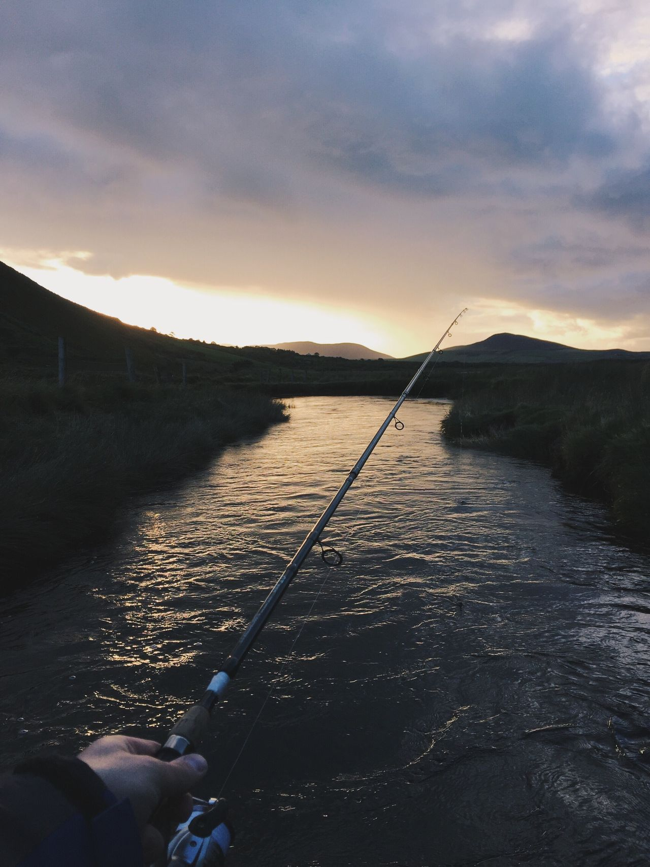 Fishing Fishing Fishing Rod Fishing Pole Water Sunset Sky Tranquility Cloud - Sky Nature Tranquil Scene Leisure Activity Real People Fishing Tackle Beauty In Nature Outdoors Catch Of Fish One Person Mountain Day Wading Salmon Fishing Troutfishing